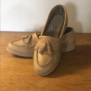 Vintage fringe top and tasseled leather loafers.